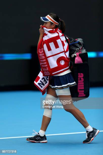 Shuai Peng of China leaves the court after retiring due injury during the match against Jelena Ostapenko of Latvia on day six of the 2017 China Open...