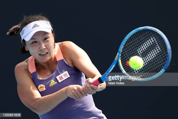 Shuai Peng of China plays a backhand during her Women's Singles first round match against Nao Hibino of Japan on day two of the 2020 Australian Open...