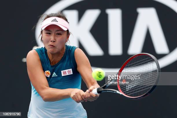 Shuai Peng of China plays a backhand in her first round match against Eugene Bouchard of Canada during day two of the 2019 Australian Open at...