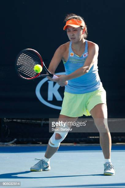 Shuai Peng of China plays a backhand in her first round match against Marta Kostyuk of Ukraine on day one of the 2018 Australian Open at Melbourne...