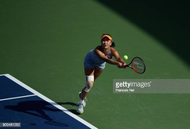Shuai Peng of China plays a backhand in her match against Elena Vesnina of Russia during day one of the WTA Dubai Duty Free Tennis Championship at...