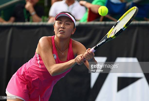 Shuai Peng of China plays a backhand in her match against Lucia Hradecka of the Czech Republic during day three of the 2012 ASB Classic at the ASB...