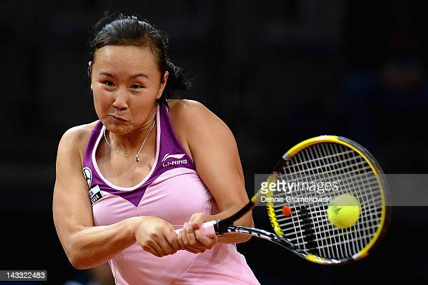 Shuai Peng of China plays a backhand in her match against Samantha Stosur of Australia during day two of the WTA Porsche Tennis Grand Prix at Porsche...