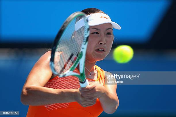 Shuai Peng of China plays a backhand in her third round match against Ayumi Morita of Japan during day six of the 2011 Australian Open at Melbourne...