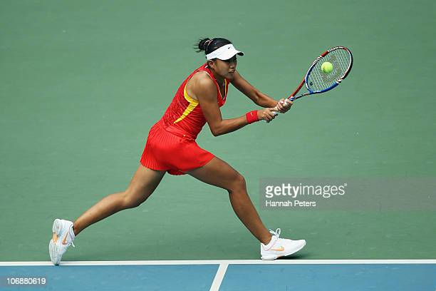 Shuai Peng of China plays a backhand in the Women's Team Doubles Tennis Semifinal match against Nudnida Luangnam and Varatchaya Wonteanchai of...