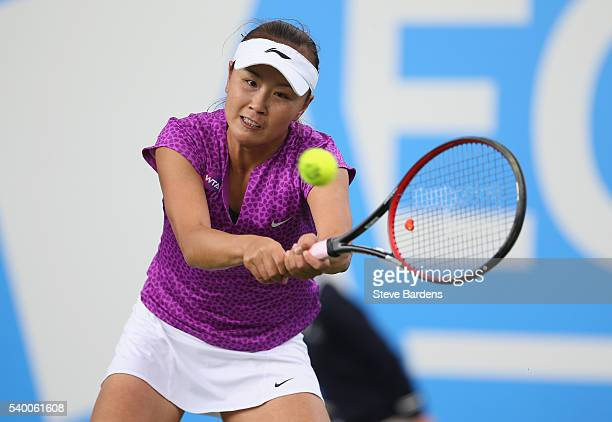 Shuai Peng of China plays a forehand during her women's singles first round match against Angelique Kerber of Germany on day two of the WTA Aegon...
