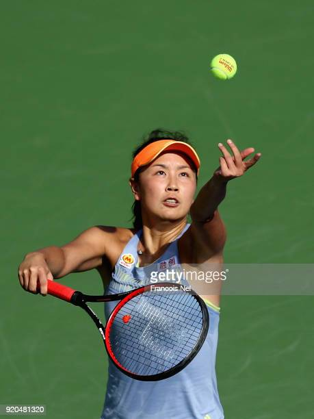 Shuai Peng of China plays serves in her match against Elena Vesnina of Russiaduring day one of the WTA Dubai Duty Free Tennis Championship at the...
