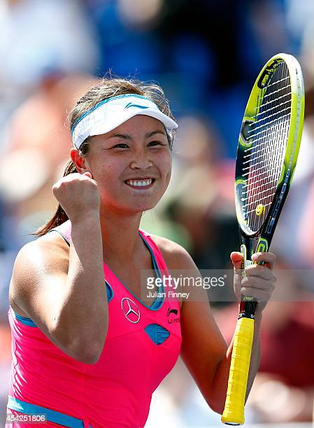 Shuai Peng of China reacts after defeating Agnieszka Radwanska of Poland on Day Three of the 2014 US Open at the USTA Billie Jean King National...