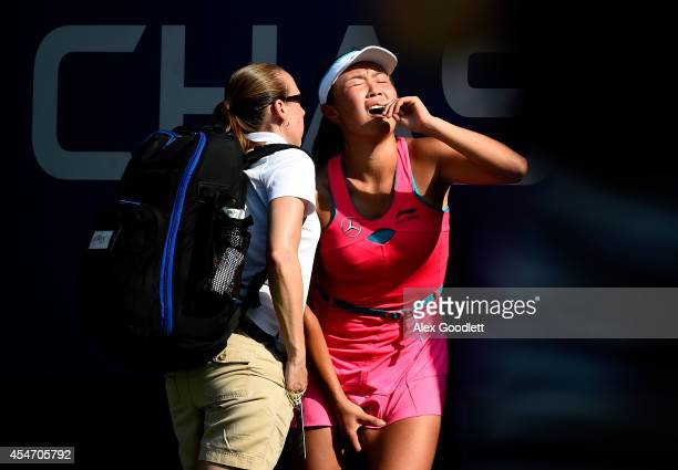 Shuai Peng of China reacts after getting injured during her women's singles semifinal match against Caroline Wozniacki of Denmark on Day Twelve of...
