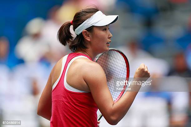 Shuai Peng of China reacts during a match against Shuai Zhang of China during their second round match on Day two of the 2016 Dongfeng Motor Wuhan...