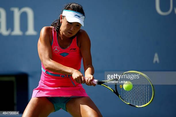 Shuai Peng of China returns a shot against Caroline Wozniacki of Denmark during their women's singles semifinal match on Day Twelve of the 2014 US...