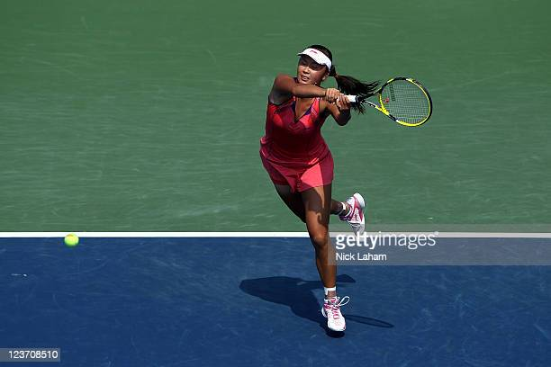 Shuai Peng of China returns a shot against Flavia Pennetta of Italy serves against during Day Seven of the 2011 US Open at the USTA Billie Jean King...