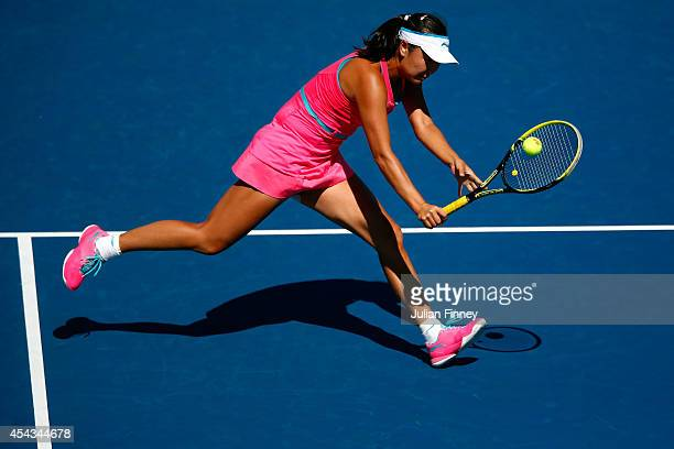 Shuai Peng of China returns a shot against Roberta Vinci of Italy during their women's singles third round match on Day Five of the 2014 US Open at...