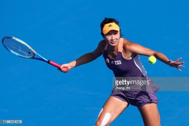 Shuai Peng of China returns a shot during the match against Ekaterina Alexandrova of Russia on Day 4 of 2020 WTA Shenzhen Open at Shenzhen Longgang...
