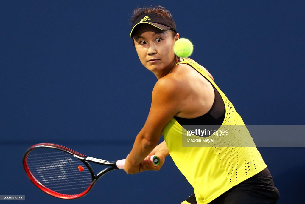 Shuai Peng of China returns a shot to Agnieszka Radwanska of Poland during their match on Day 7 of the Connecticut Open at Connecticut Tennis Center at Yale on August 24, 2017 in New Haven, Connecticut.