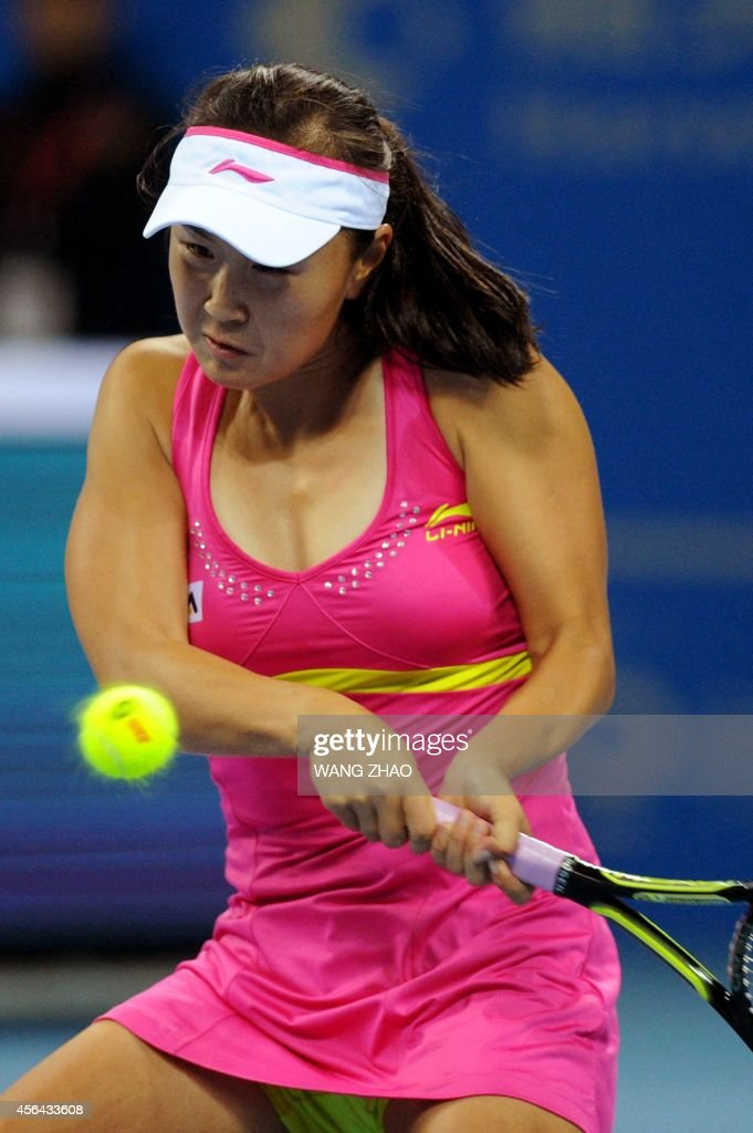 Shuai Peng of China returns to Petra Kvitova of Czekh during their women's singles second round match at the China Open tennis tournament in the National Tennis Center of Beijing on October 1, 2014. Petra Kvitova won 6-4, 6-2.