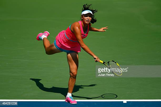 Shuai Peng of China serves against Agnieszka Radwanska of Poland on Day Three of the 2014 US Open at the USTA Billie Jean King National Tennis Center...