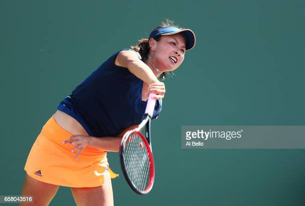 Shuai Peng of China serves against Samantha Stosur of Australia during Day 7 of the Miami Open at Crandon Park Tennis Center on March 26 2017 in Key...