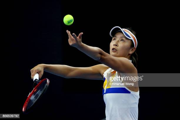 Shuai Peng of China serves against Shelby Rogers of USA on day three of the 2017 China Open at the China National Tennis Centre on October 1st 2017...