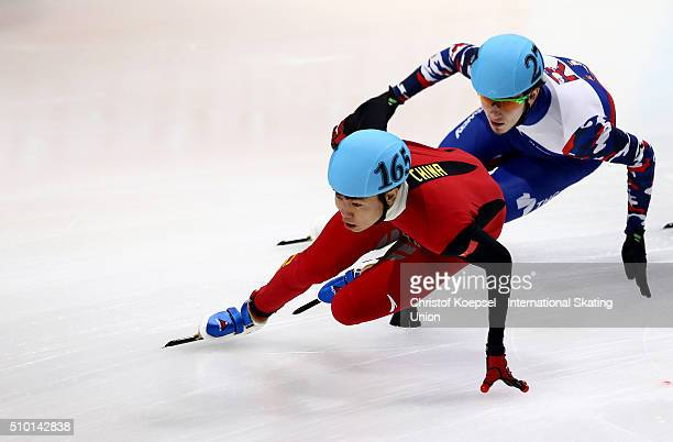 Shuai Shao of China and Dmitry Migunov of Russia compete during the men 1000m quarterfinals heat two during Day 2 of ISU Short Track World Cup at...