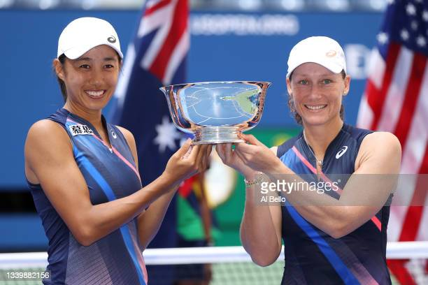 Shuai Zhang of China and Samantha Stosur of Australia celebrate with the championship trophy after defeating Coco Gauff of the United States and...