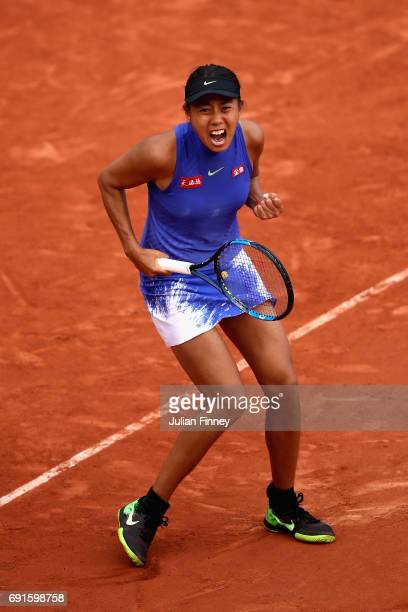 Shuai Zhang of China celebrates a point during ladies singles third round match against Svetlana Kuznetsova of Russia on day six of the 2017 French...