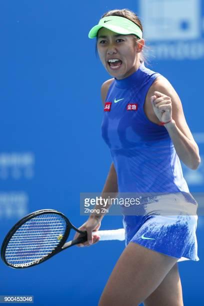 Shuai Zhang of China celebrates a point during the match against Zarina Diyas of Kazakhstan during Day 3 of 2018 WTA Shenzhen Open at Longgang...