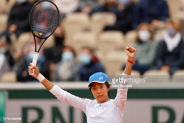 Shuai Zhang of China celebrates after winning match point during her Women's Singles third round match against Clara Burel of France on day seven of...