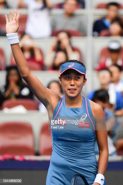 Shuai Zhang of China celebrates against Timea Babos of Hungary during their Women's Singles 2nd Round match of the 2018 China Open at the China...
