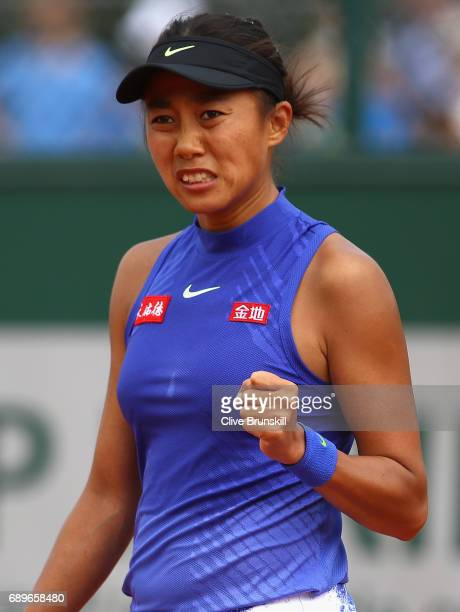 Shuai Zhang of China celebrates during the ladies singles first round match against Donna Vekic of Croatia on day two of the 2017 French Open at...