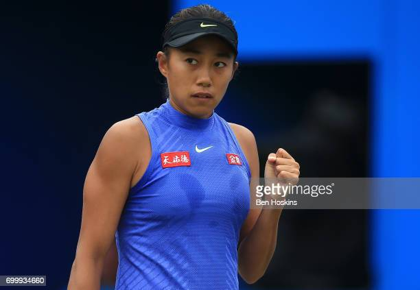 Shuai Zhang of China celebrates winning a point during the second round match against Kristina Mladenovic of France on day four of The Aegon Classic...