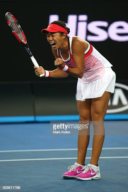 Shuai Zhang of China celebrates winning her first round match against Simona Halep of Romania during day two of the 2016 Australian Open at Melbourne...