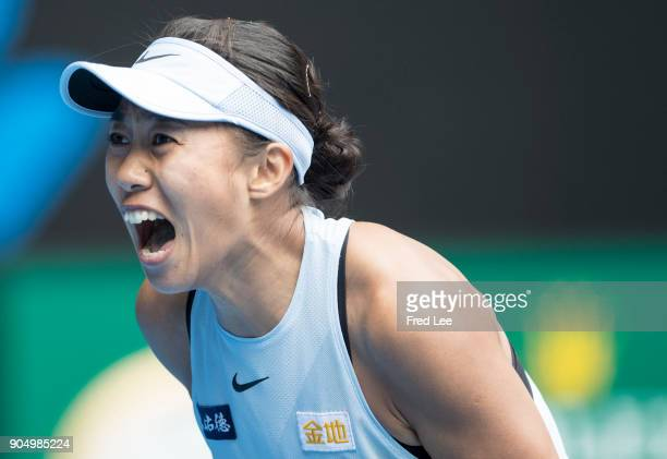 Shuai Zhang of China celebrates winning her first round match against Sloane Stephens of the United States on day one of the 2018 Australian Open at...