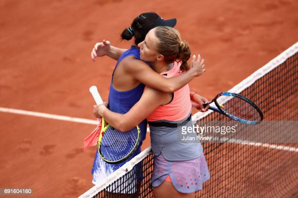Shuai Zhang of China congratulates Svetlana Kuznetsova of Russia on victory in the ladies singles third round match on day six of the 2017 French...