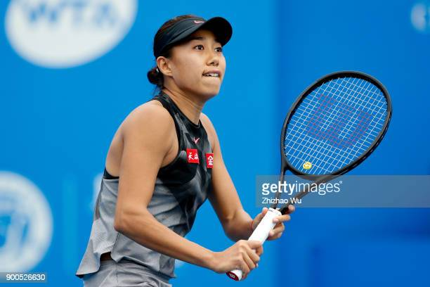Shuai Zhang of China in action during the match against Zarina Diyas of Kazakhstan during Day 3 of 2018 WTA Shenzhen Open at Longgang International...