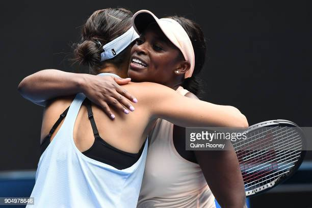 Shuai Zhang of China is congratulated by Sloane Stephens of the United States after winning their first round match on day one of the 2018 Australian...