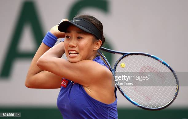 Shuai Zhang of China plays a backhand during ladies singles third round match against Svetlana Kuznetsova of Russia on day six of the 2017 French...