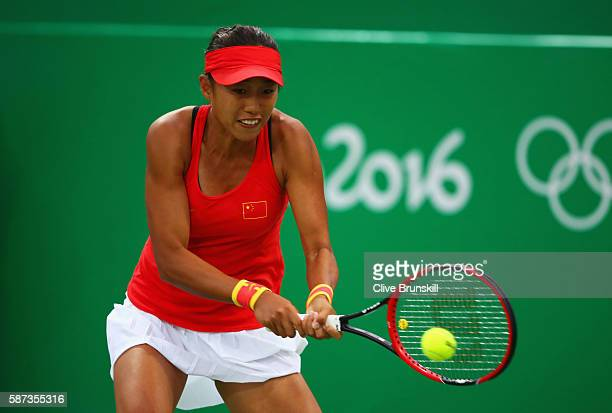 Shuai Zhang of China plays a backhand during the Women's Singles second round match against Laura Siegemund of Germany on Day 3 of the Rio 2016...