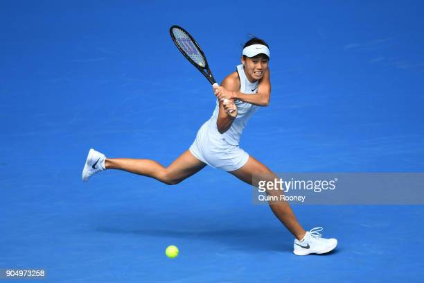 Shuai Zhang of China plays a backhand in her first round match against Sloane Stephens of USA on day one of the 2018 Australian Open at Melbourne...
