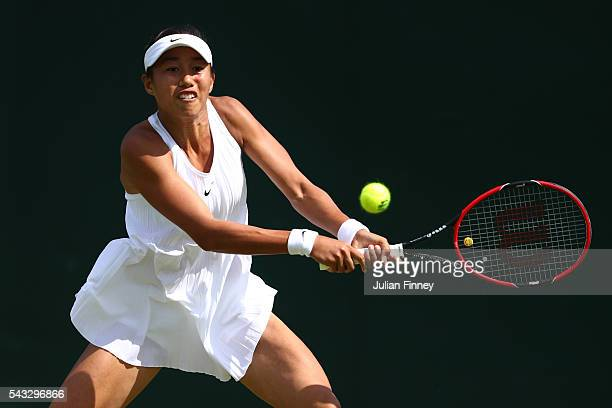 Shuai Zhang of China plays a backhand shot during the Ladies Singles first round match against Maria Sakkari of Greece on day one of the Wimbledon...