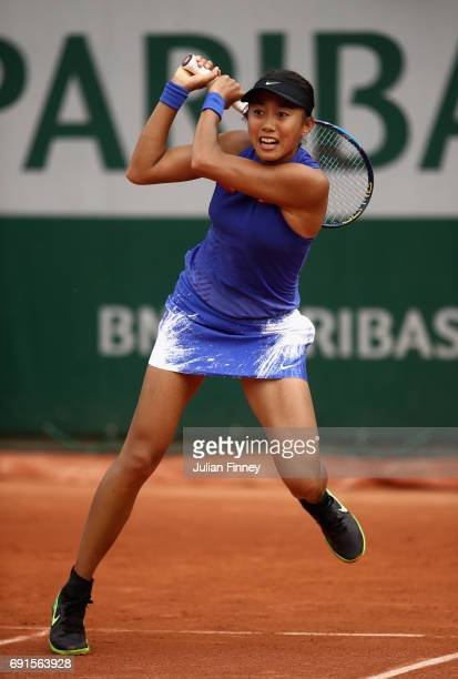 Shuai Zhang of China plays a backhand uring ladies singles third round match against Svetlana Kuznetsova of Russia on day six of the 2017 French Open...