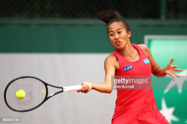 Shuai Zhang of China plays a forehand during the ladies singles first round match against Kristina Kukova of Slovakia during day three of the 2018...