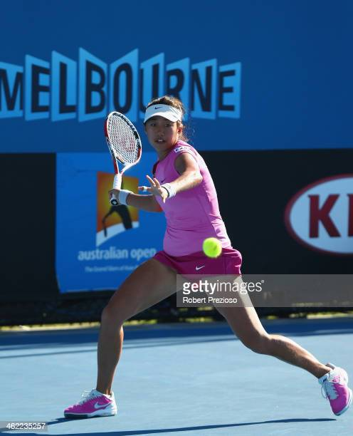 Shuai Zhang of China plays a forehand in her first round match against Mona Barthel of Germany during day one of the 2014 Australian Open at...