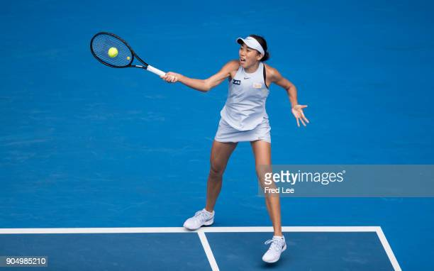 Shuai Zhang of China plays a forehand in her first round match against Sloane Stephens of USA on day one of the 2018 Australian Open at Melbourne...