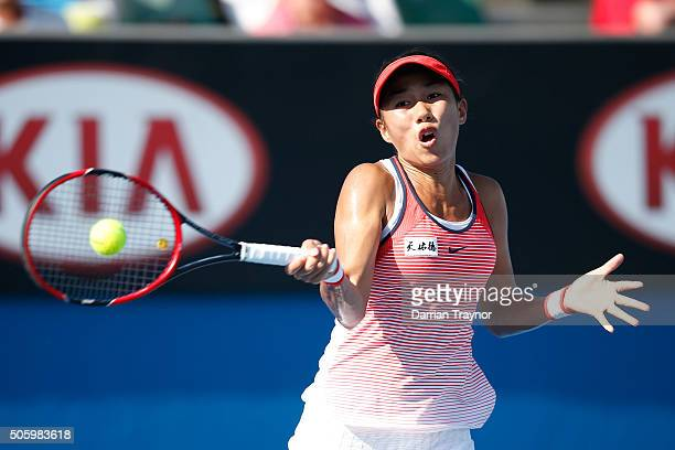 Shuai Zhang of China plays a forehand in her second round match against Alize Cornet of France during day four of the 2016 Australian Open at...