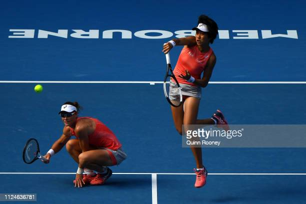 Shuai Zhang of China plays a forehand in her Women's Doubles Final match with Samantha Stosur of Australia against Timea Babos of Hungary and...