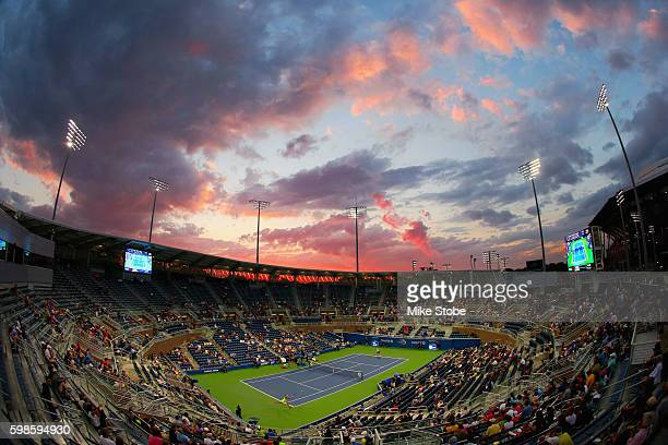Shuai Zhang of China plays against Samantha Stosur of Australia on Grandstand in their second round Women's Finals match as the sun sets on Day Four...