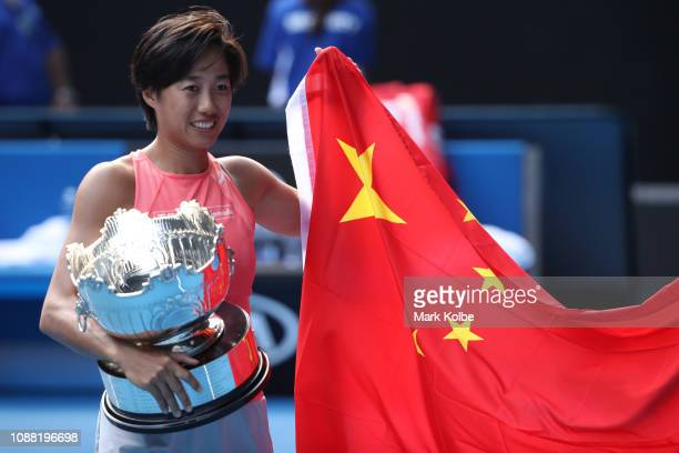 Shuai Zhang of China poses with the cup after winning her Women's Doubles Final match with Samantha Stosur of Australia against Timea Babos of...