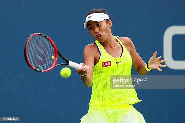 Shuai Zhang of China returns a shot to Yaroslava Shvedova of Kazakhstan during her third round Women's Singles match on Day Six of the 2016 US Open...