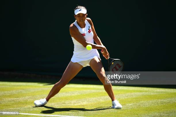 Shuai Zhang of China returns to Andrea Petkovic of Germany during their Ladies' Singles first round match on day one of the Wimbledon Lawn Tennis...